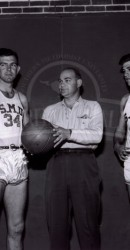 1946-47 Basketball L-R Bryan Lloyd, Danny Lynch, Coach Whitey Baccus, Ben Harris, Burt Rollings