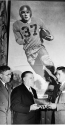 1948 Dr. Ewell Walker Watches Doak Receive The Maxwell Award