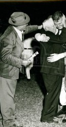 """1953 Don """"Tiny"""" Godd and Father Overcome after Ponies Beat Rice 12-7"""